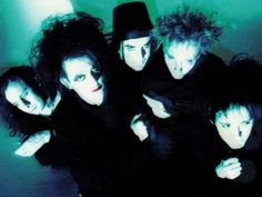 The Cure  British Rock Band  part of the post-punk and new wave movements that had sprung up in the wake of the punk rock revolution in the United Kingdom. During the early 1980s, the band's increasingly dark and tormented music helped form the gothic rock genre.   By the start of the 1990s, The Cure were one of the most popular alternative rock bands in the world.