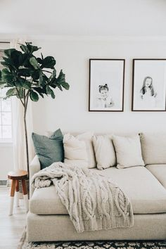minimal living room kids photos greenery interior decor decorating design white sofa, neutral living room design with fiddle fig, modern family room design Living Room Interior, Home Living Room, Apartment Living, Living Room Designs, Living Room Furniture, Living Area, Furniture Stores, Living Room Decor Simple, Cream Living Room Decor