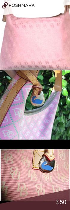 Dooney and Bourke purse Dooney and Bourke shoulder hobo small purse. Pen leak stain on the inside. The outside of the purse is in perfect condition. Dooney & Bourke Bags Shoulder Bags