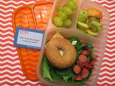 What's packed for lunch? Apple from our own tree, grapes, a leftover hotdog, a bagel with cheese, and a bed of spinach, in an #Easylunchboxes