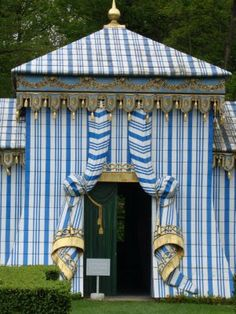 The Tente Tartare on the grounds of the Chateau de Groussay, Montfort-l'Amaury, France, is constructed of painted wood and is not actually a tent. The main house was built in 1815, and the Tente Tartare was build in 1960.