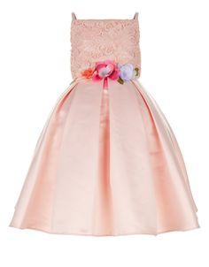 Perfect for flower girls and bridesmaids, our Leona occasion dress for girls is crafted with a floral lace bodice, 3D flower appliqués on the waist and a full duchess satin skirt with box pleats. Lined for a comfy fit, this pretty piece is finished with a tie-up satin bow on the back. Features a zip fastening.