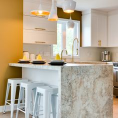 Laminate countertops have come a long way! Amazing... this is 180fx® Laminate Golden Mascarello on this kitchen countertop.  Pairing with white cabinets and brass hardware for a stunning combination.