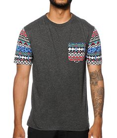 A tagless design will keep you comfortable while a multicolor tribal print left chest pocket and sleeves will update your style with a fresh look.