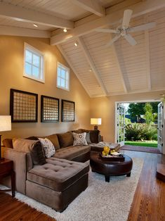 Love this room. High ceiling, French doors, big couch, wood floors, calm colors