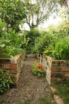 Brick raised gardens - beautiful and low maintenance. #KitchenGarden