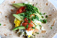 Huevos Rancheros wraps. I need to go to the store so I can make this right now!!!