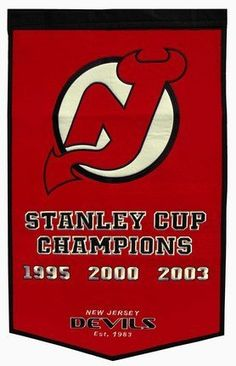 """Winning Streak New Jersey Devils Dynasty Banner - New Jersey Devils 24 x 36 Inches by Winning Streak. $65.73. The officially licensed 24"""" x 36"""" wool and acrylic New Jersey Devils Dynasty Banner from Winning Streak is decorated in the team colors and designed with the embroidered commemorative graphics celebrating the team's Stanley Cup(r) Championship years.. Save 27%!"""