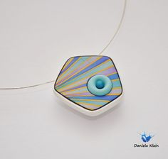 You can see Daniela Klein's perfectly executed and finished work here in this pendant created in a class by Dan Cormier's.  The colors of polymer clay blend together perfectly.  You can see more of her work and her journey in her Flickr photostream.  The Polymer Arts magazine.  www.thepolymerarts.com