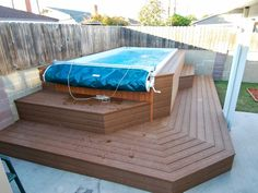 A backyard Endless Pools Swim Spa built into a raised deck.