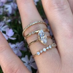 This stunning stack features our Helen wedding band, Harper wedding band, Clio marquise engagement ring and the Avery wedding band. Marquise Wedding Set, Gold Diamond Wedding Band, Wedding Band Sets, Wedding Rings Vintage, Marquise Cut, Stacked Engagement Ring, Gold Band Engagement Rings, Engagement Ring Cuts, Solitaire Setting