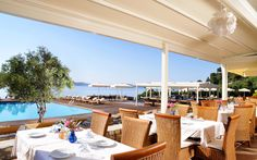 Pasteria Italiana. Enjoy a meal next to the swimming pool while enjoying the view of the Aegean sea. Visit www.kassandrabay.com/hotel-restaurant for more information. Swimming Pools, Meal, Restaurant, Patio, Table Decorations, Luxury, Outdoor Decor, Food, Home Decor