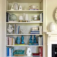 living room bookcase styling - interior design -home staging expert - Lotte Meister - photo by Laurel Bern