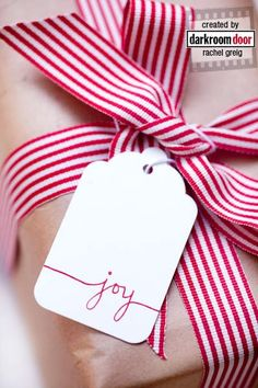 The simplicity of a candy-striped ribbon with a simple handmade tag