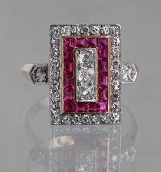Let's enjoy one last ruby jewel before July, the ruby month, is over. This unique Art Deco ring made in France around 1930 and now offered by Tadema Gallery features 5 larger white diamonds of 0.25 cts total, sixteen square rubies of approximately 0.35 ct. t.w. and a row of outer diamonds of cca 0.42 cts total. The splendid square-cut stones match the striking rectangular design of this golden treasure and make the ring really stand out. www.diamonds.pro