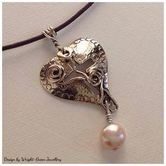 Silver rose heart design pendant