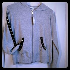 Grey Hoodie With Black Lining and Silver Grommets. Cute grey hoodie, sleeves lined with black ribbon and silver grommets. Tops Sweatshirts & Hoodies