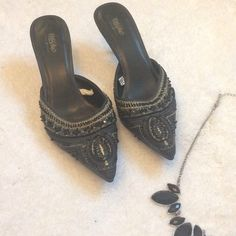 Pointy-toe Heel with Beaded Embellishment Probably worn 1-2x. Simple black heel with some flair. Heel is approximately 2-3 inches tall. Cool beadwork, sequins and stitching in black and gold. Size 7.5. Shoes Heels