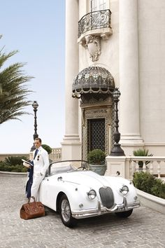 The husband, his favorite car, and one of our abodes. (Wealth and Luxury)