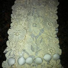 Lace from Mom's wedding dress for daughter's bouquet wrap. With Gramma' brooch to hold it in place.