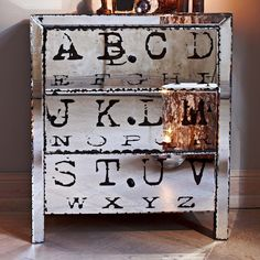 what a cool piece of furniture! drawers mirror print vintage feel...