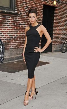 Eva Longoria looked stunning with this fitted black dress and satin heels.