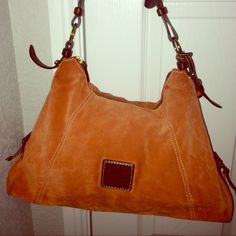 Dooney & Bourke orange & brown suede purse. Authentic Dooney & Bourke orange & brown suede purse  13X4X10 Item Specifics Authentic Brand-Dooney & Bourke Material-Suede  Style-Hobo Color orange & brown CategoryHandbags & Purses in Clothing, Shoes & Accessories. Non-Smoker Dooney & Bourke Bags Hobos