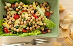This quick and easy meal is a testament to the satisfaction of a good main course salad and is just one example of how to include healthy, protein-packed beans in a warm-weather menu. It's simple to double this recipe for two, or increase further to serve even more. Maybe it will become the summer potluck dish you're famous for! Serve with pita chips or warm pita bread on the side.