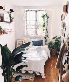 Boho bed room bedroom white bright light window rug plants shelf shelving open