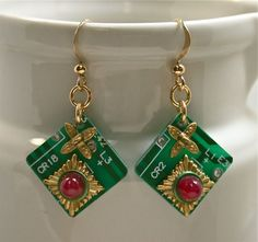 Recycled bright green circuit board earrings that showcase ornate vintage brass jewelry findings, a vintage German red glass cabochon, and a dot of green anodized aluminum for a very geeky look to iss