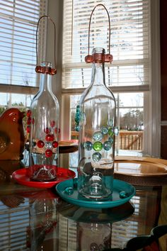Bird feeders made from recycled wine bottles . were easy to prepare!