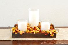 Here's what I used to create the candle centerpiece:    wood tray from Hobby Lobby    Rustoleum dark walnut stain    Candle vases from the Dollar Store    Berry picks and garland    candles