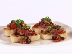 Get Giada De Laurentiis's Halibut with Artichoke and Olive Caponata Recipe from Food Network