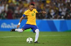 Neymar of Brazil scores the winning penalty in the penalty shoot out during the Men's Football Final between Brazil and Germany at the Maracana Stadium on Day 15 of the Rio 2016 Olympic Games on August 20, 2016 in Rio de Janeiro, Brazil.