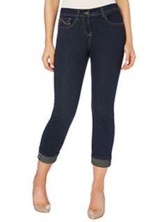 "Make an essential addition to your capsule wardrobe with these girlfriend jeans. In a classic five pocket construction, these dark denim jeans are designed with a tapered leg and upturned cuffs. Style with a structured top and brogues for a pretty finish. Blue dark denim girlfriend jeans 5 pockets Tapered leg Upturned cuffs Zip-fly and button fastening Model's height is 5'11"" Model wears a size 12"