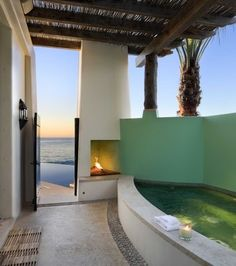 hot tub and fireplace--tropical patio by Ike Kligerman Barkley