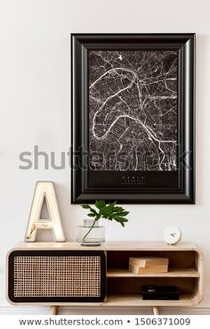 Stock Photo: Modern scandinavian living room interior with black mock up poster map frame, design commode, tropical leaf, books, cement letter and elegant accessories. Stylish home decor. Scandinavian Interior Living Room, Room Interior, Map Frame, Framed Maps, Stylish Home Decor, Tropical Leaves, Decoration, Cement, Letter