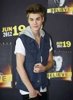 Canadian singer Justin Bieber poses for photographers before a press conference on his upcoming concert at the Zocalo square, in Mexico City, on June 11, 2012.