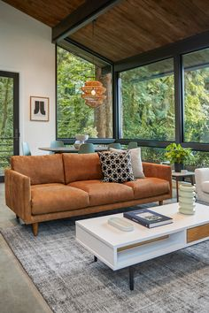 You know your dad's incredible vintage bomber jacket? The Nirvana Dakota Tan leather sofa is that jacket, but in couch form. Mid Century Modern Living Room, Mid Century House, Retro Home Decor, Home Decor Styles, Home Living Room, Living Room Decor, Airstream Interior, Cabin Interiors, My New Room