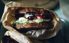 ideal item to make on weekends: bacon, fried egg, slow baked tomatoes, creme fraiche vinaigrette, frisee