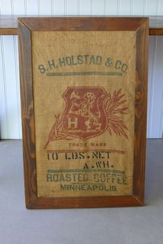 Striking old vintage coffee sack in a rustic wood frame, as found. I love the large red trademark and type. Colors are muted yet graphics look strong