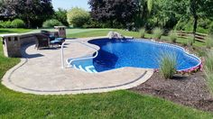 Radiant Semi-Inground Freeform with walk-in steps and water feature