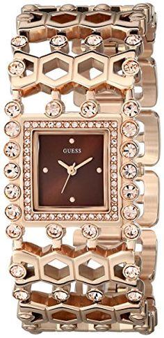 GUESS Women's U0574L3  Feminine Rose Gold-Tone Watch with Brown Dial, Genuine Crystals & Self-Adjustable Links GUESS http://www.amazon.com/dp/B00NPLTHAU/ref=cm_sw_r_pi_dp_o4N2vb1N6V53T