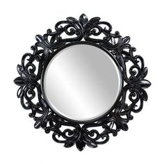 Ornate wall mirror with intricate openwork frame and a hand-detailed finish.  Product: Mirror  Construction Material: