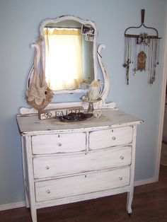 My newly painted and refreshed antique dresser.