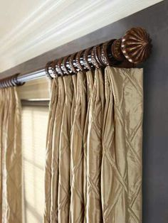 the decorative traverse rods are both elegant and functional in these setups the drapes are attached to the rod with the help