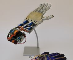 This is my school project for the 5th year of high school (I'm Italian, we have 5 years of high school).It consists in an artificial hand controlled by a glove with...
