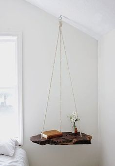 Create a hanging table. Take an old and large enough piece of wood. Sand it to create a smooth surface. Visit your local hardware store to drill three holes in a triangular shape. You will also need a toggle lock – eye screw and S-hook.