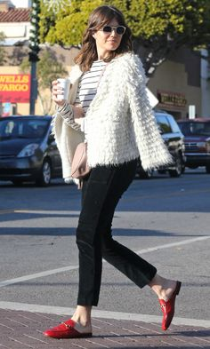 Mandy Moore in a striped top, white ruffle jacket, black pants and red loafers - click through for more celebrity winter outfit ideas