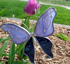 BluePurple Haze Stained Glass Butterfly by dortdesigns on Etsy - these butterflies adorned the casket spray at my mother's funeral, and made it very special.  Her grandchildren and great-grandchildren each went home with one, and the butterflies have become a cherished memento.